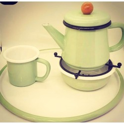 A tea serving set consisting of a teapot - hot plate - cup - tray
